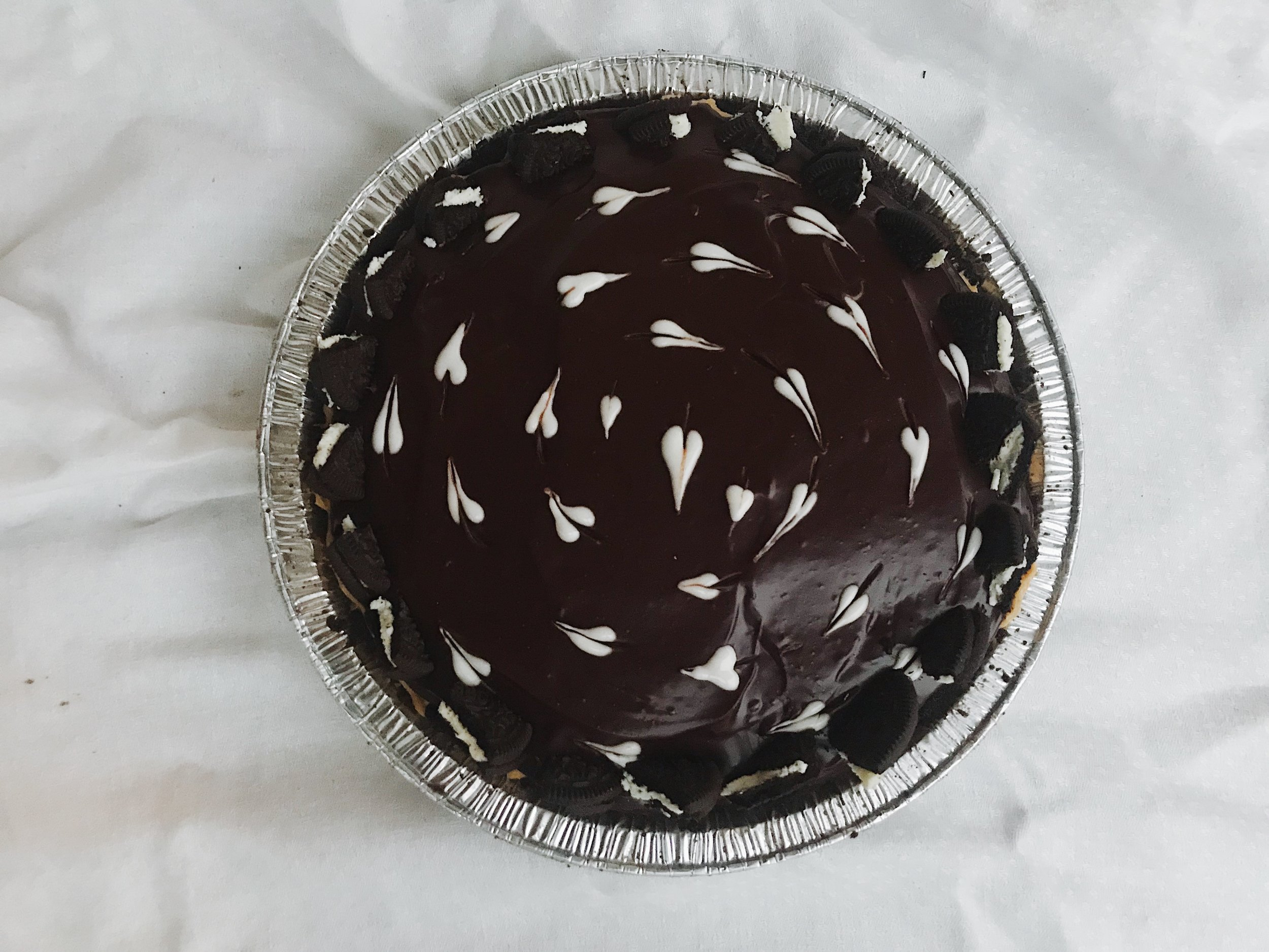 Peanut butter mousse pie topped with chocolate ganache and sea salt