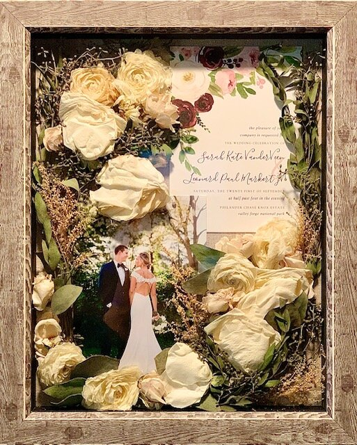 "11x14"" shadow box with silicate preserved flowers, 5x7 photo and invitation."