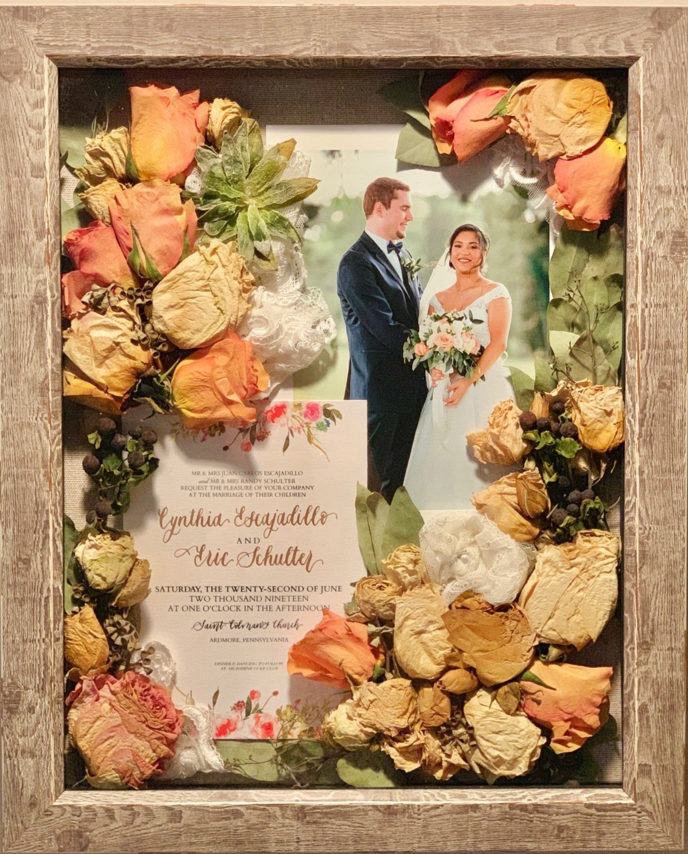 "Preserved (not pressed) bouquet from wedding in 2"" deep shadow box. 11""x 14"" reclaimed barn wood frame with 5 x 7 print of bride and groom on the wedding day. Brides can deliver bouquets, invitations, photos, swatches of dress fabric, groom's boutonnieres, cuff links, etc to be preserved in a hanging shadowbox. See  Contact Page  to inquire about preserving flowers from weddings, proms, recitals, engagements, funerals, etc."