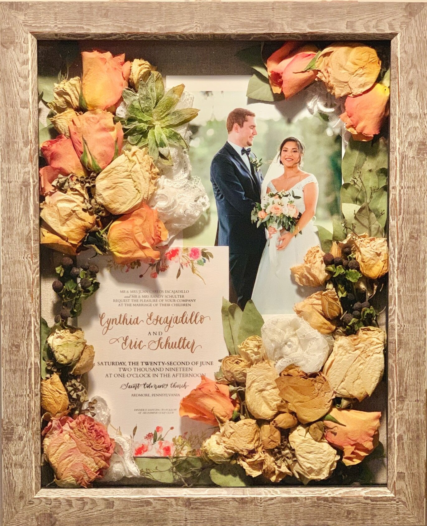 """Preserved (not pressed) bouquet from wedding. 11""""x 14"""" reclaimed barn wood frame with 5 x 7 print of bride and groom on the wedding day. Brides can deliver bouquets, invitations, photos, swatches of dress fabric, groom's boutonnieres, cuff links, etc to be preserved in a frame or hanging shadowbox. See  Contact Page  to inquire about preserving flowers from weddings, proms, recitals, engagements, funerals, etc. For other examples of work, click  here ."""