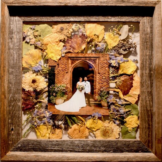 "12x12"" reclaimed frame with 6x6"" square photo and pressed flowers."