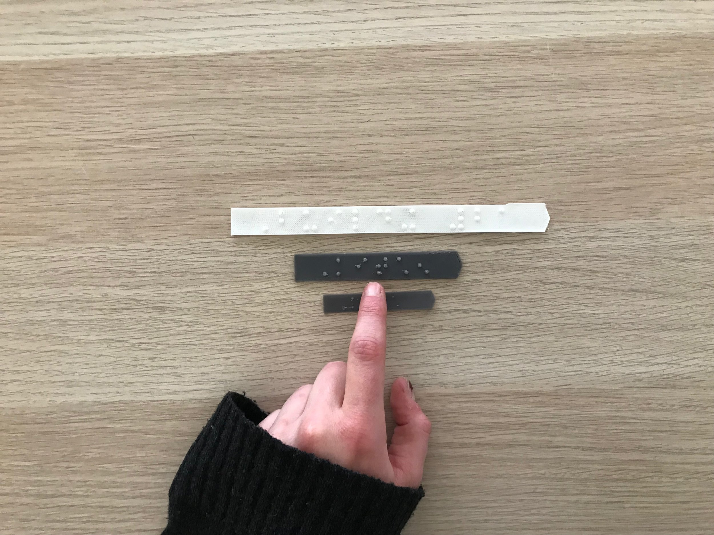Braille Labels 3D Printed.jpeg