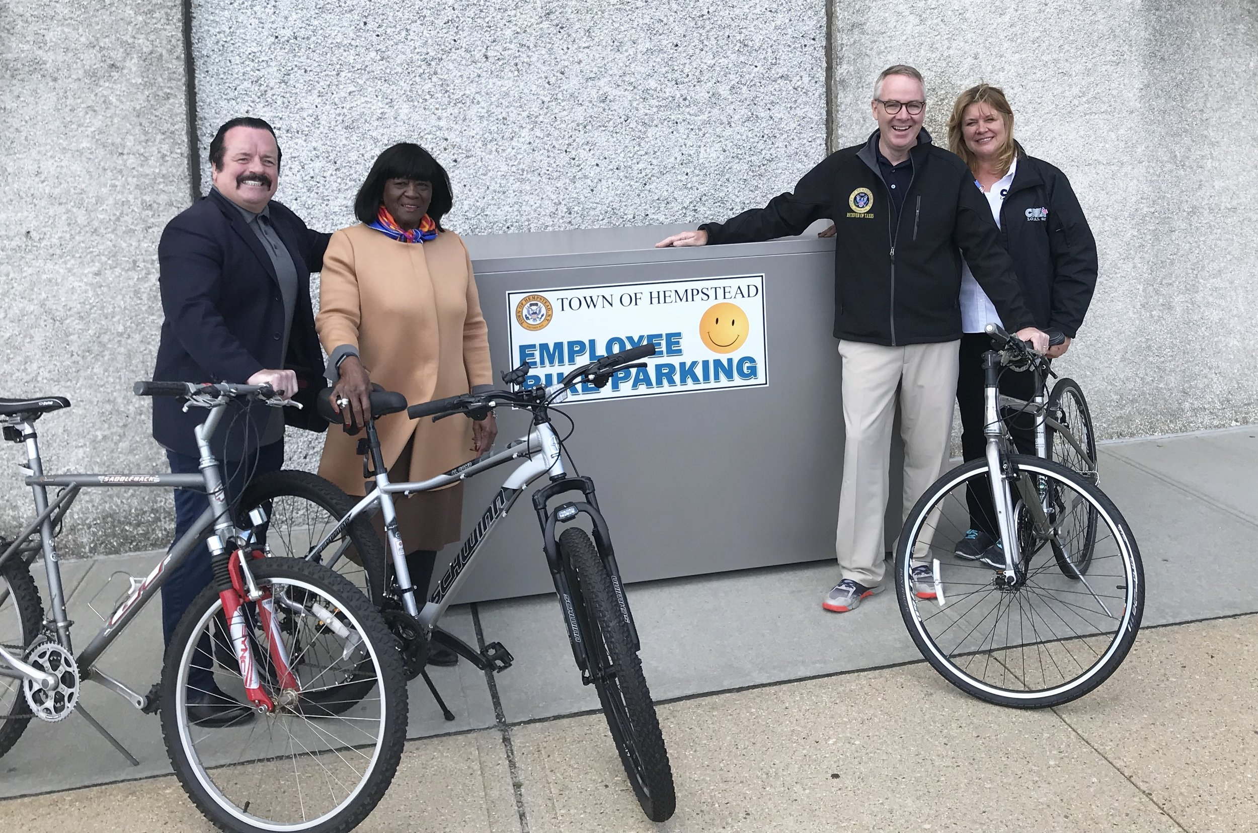 Don Clavin (2nd right) with Senior Councilwoman Dorothy Goosby (2nd left), CSEA Local 880 President Theresa Kohutka (right) and Public Safety Department Employee Ed Powers (left) during a National Employee Health and Fitness Month event. Clavin unveiled new bike lockers to help promote healthy lifestyles for town workers.