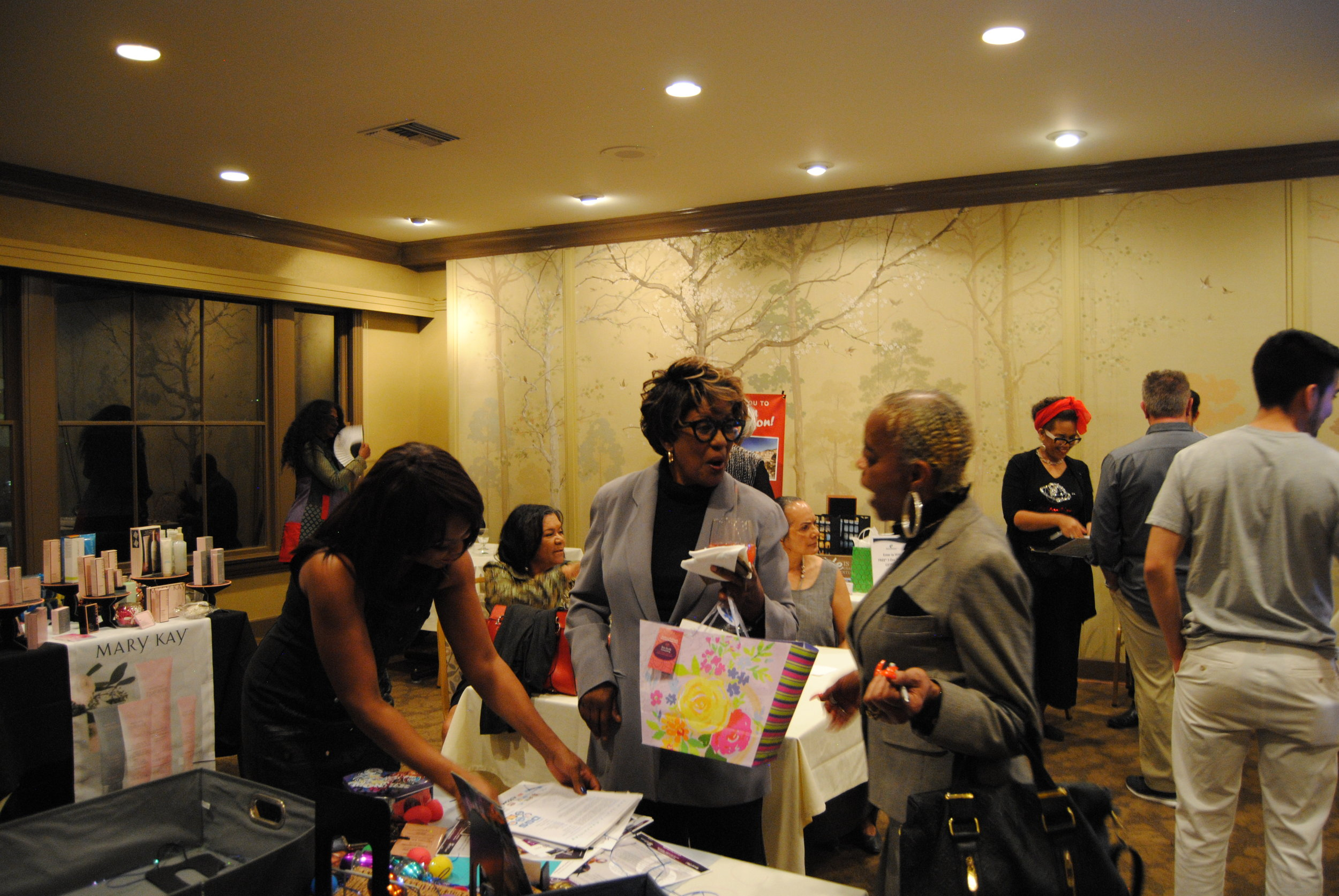 Sam Scully (left) Pamela Mims,  Mims Business Consulting  (center) visits the Indigo Staffing table