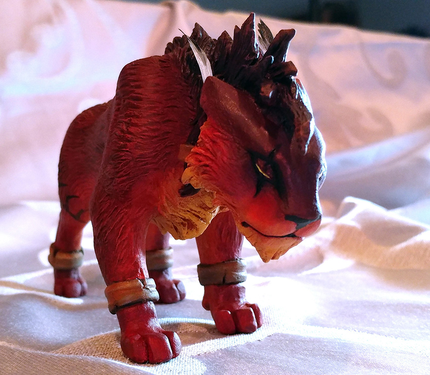 """Polymer clay sculpture of Red XIII from Final Fantasy. 3"""" tall by 7"""" long."""