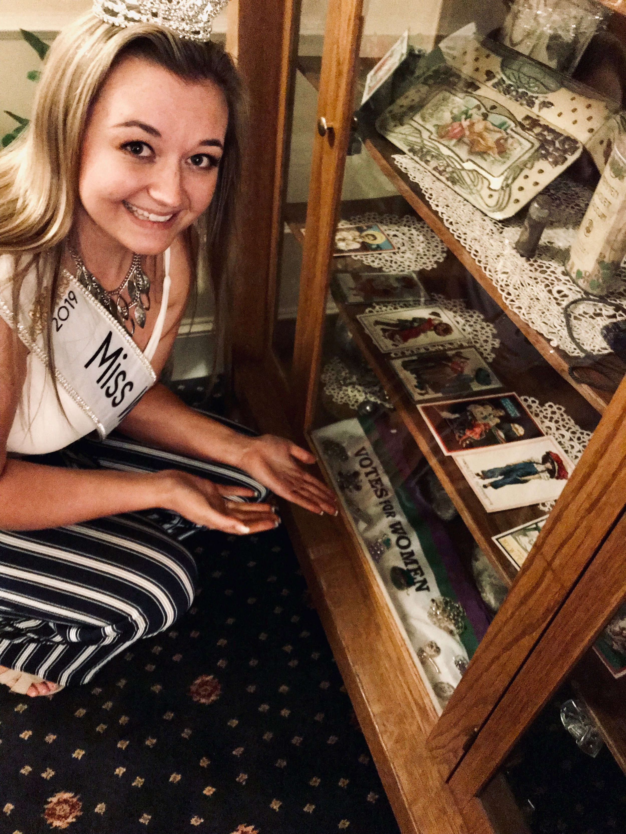 Jordan showing memorabilia of the women's suffrage in Cheyenne, Wyoming.