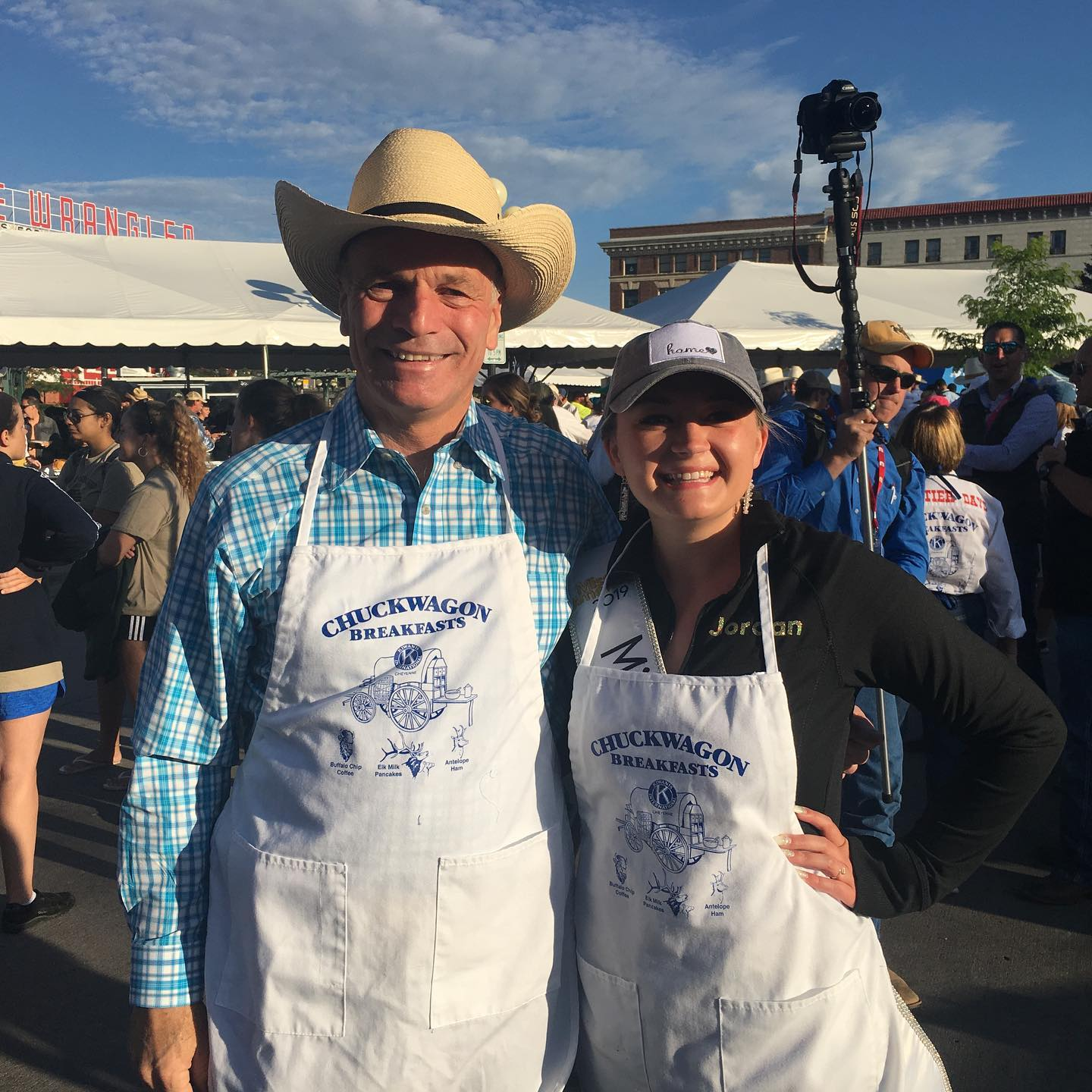 Jordan offering help with the annual Chuckwagon breakfast at the 2019 Cheyenne Frontier Days with Wyoming's Governor, Mark Gordon.