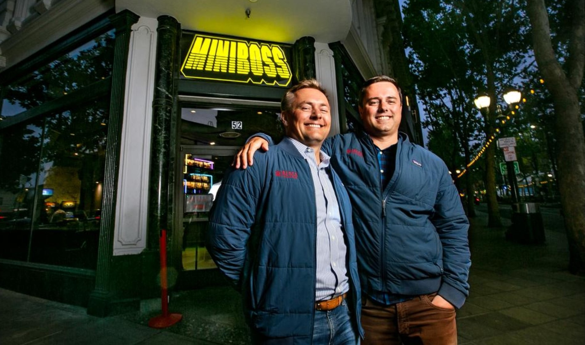 From left, brothers Jason and Chris Freise of REDCO Development in front of MiniBoss, a new bar and arcade that was one of Chris' pet projects until Lift Partners sold the property.