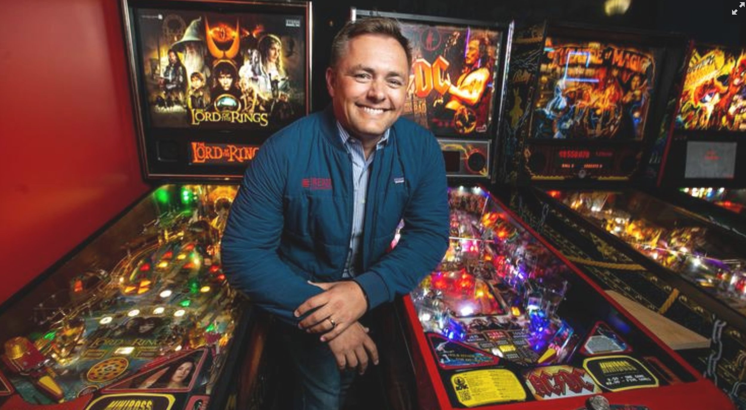 Jason Freise of REDCO Development, near the pinball machines at Miniboss arcade bar, which is located in a downtown San Jose property known as the Saratoga Capital Building.