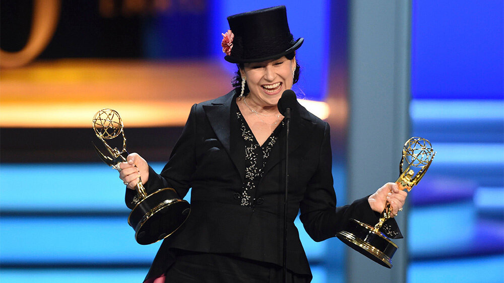 Creator Amy Sherman-Palladino, shown here holding the ghost Emmys she won for Gilmore Girls.