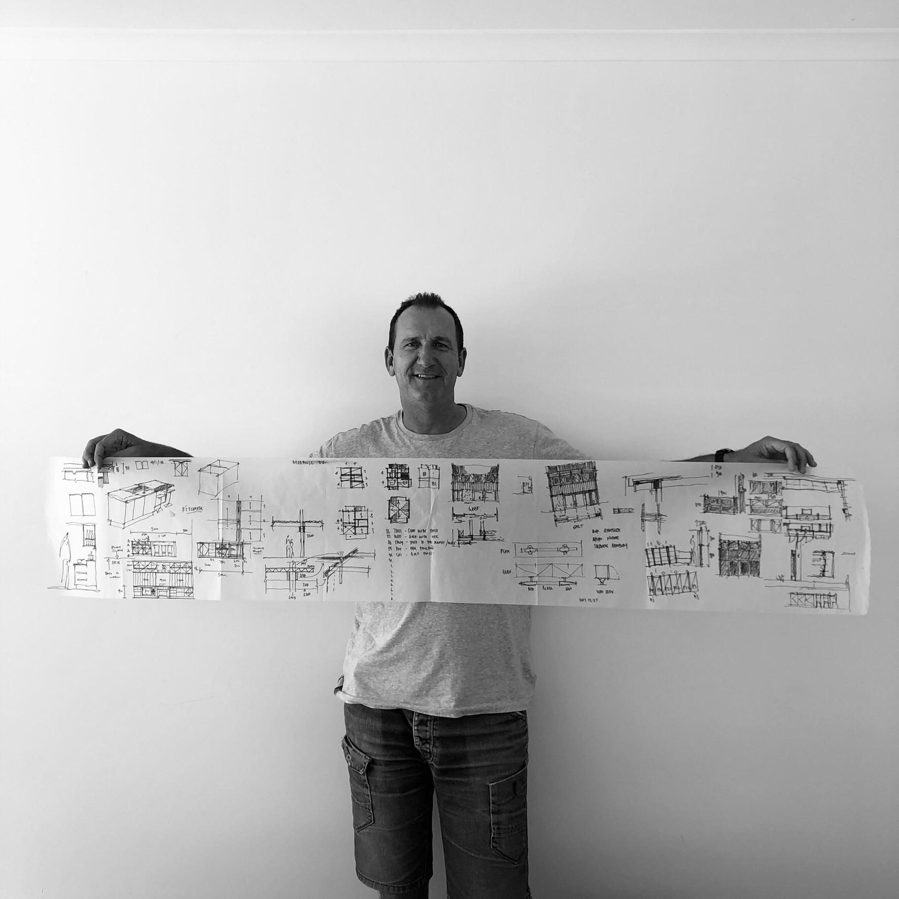 john with handrawn plans .JPG