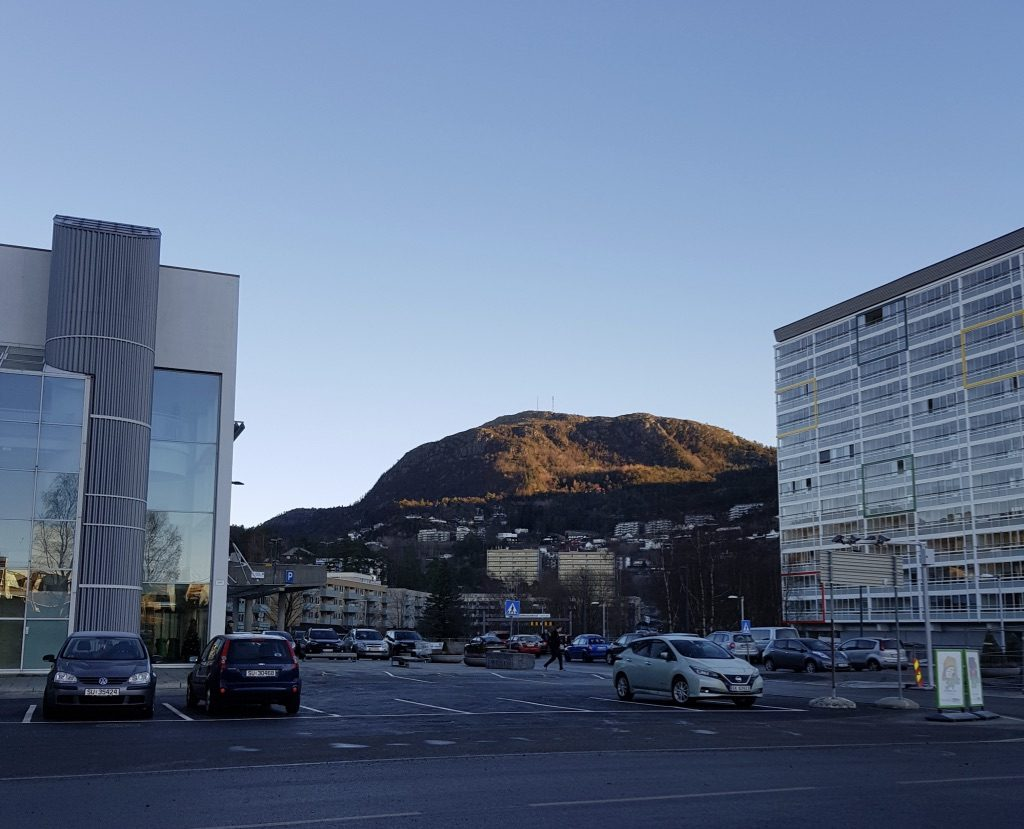 Mt Løvstakken, watching over Fyllingsdalen, one morning. In front, the local mall on the left and an apartment building on the right. This is what I see on my walk to work.