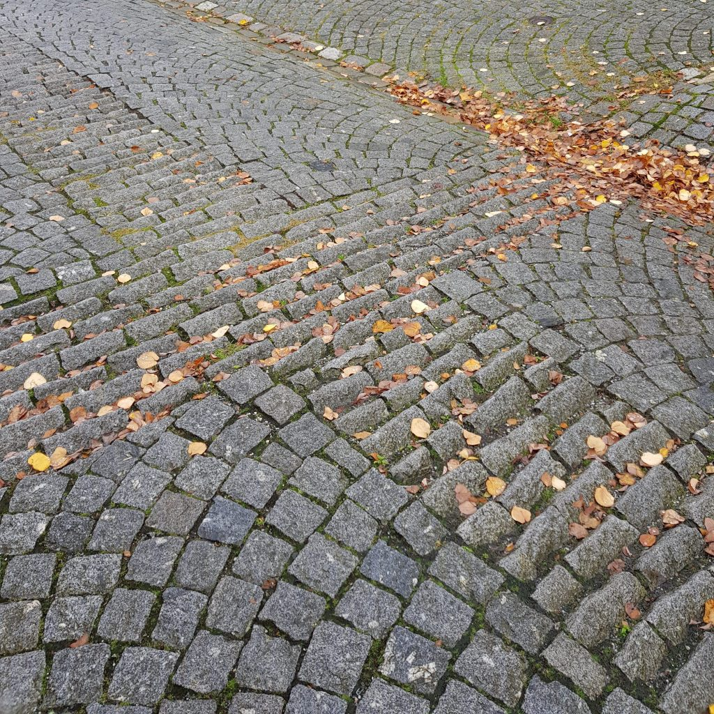 Speaking of needing help on hills: Cobblestones set at an angle helped horses towing wagons get a foothold up and down steep streets. From Sydneskleiven, Bergen, Norway