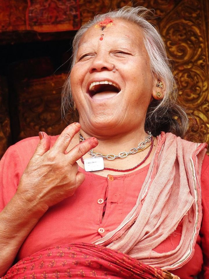 I went inside this tiny temple to find this exuberant woman inside. I gave her an offering, and she started smiling and yelling a Nepali blessing. Then, she put flowers in my hair and blessed me. She came outside, and her happiness radiated from her smile; her joy intoxicating. I proceeded to put one of the necklaces I made on her. It was such a special moment!