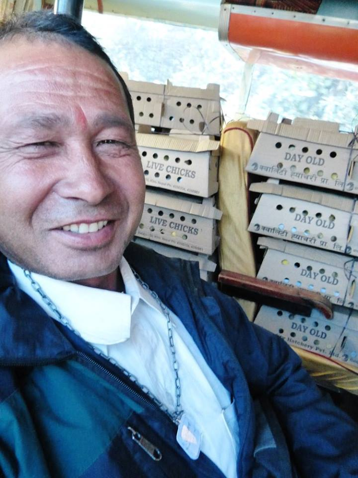 """This man was so jovial and made me smile during our long, 5-hour bus trip, so I gave him a necklace """"for his wife,"""" and he immediately put it on himself and smiled!"""