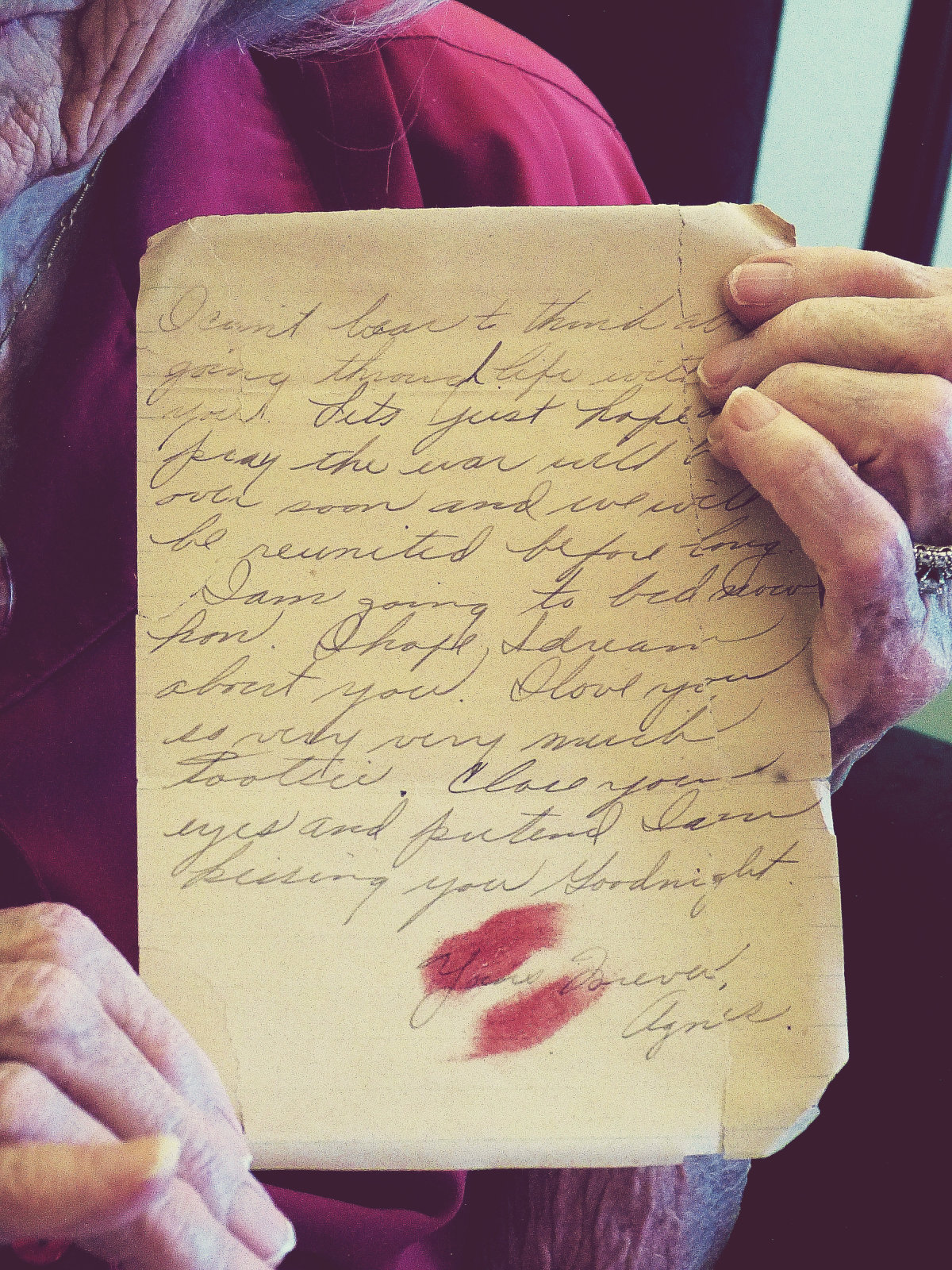 Grandma holding an original letter that she wrote to my Grandpa during WWII.