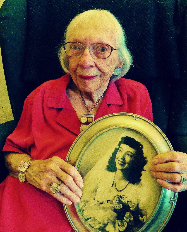 Grandma holding her wedding photo.