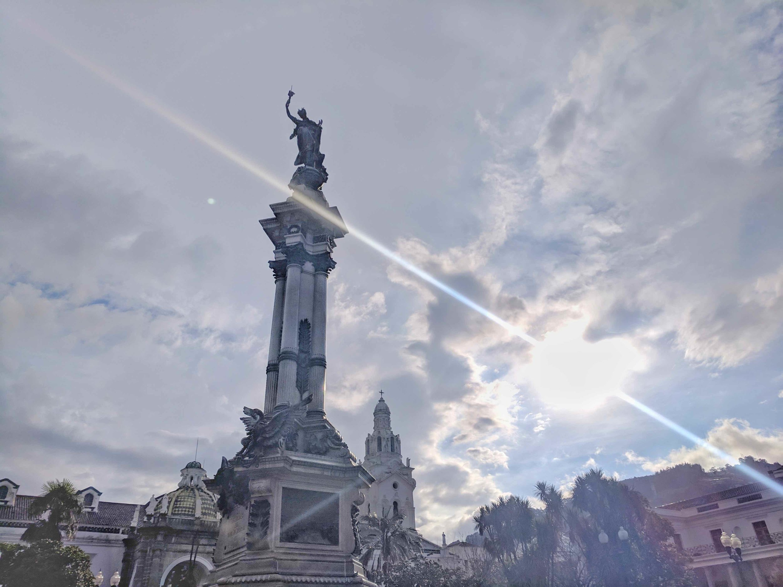 My attempt at an artsy pic of the center statue, el Monumento a la Independencia, in the park with the sun gleaming behind it