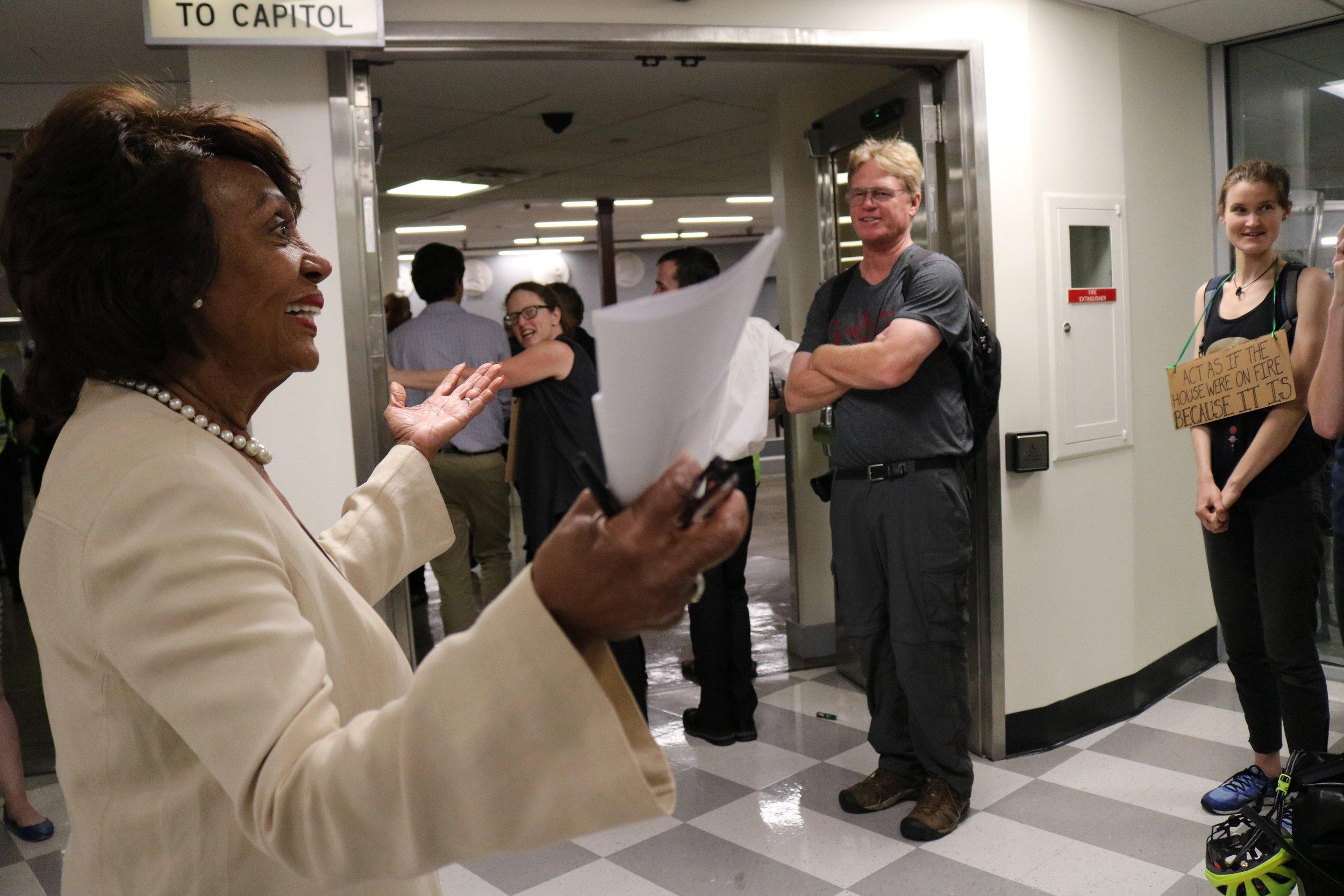 Maxine Waters celebrates the blockade. Photo: Drew Larsen