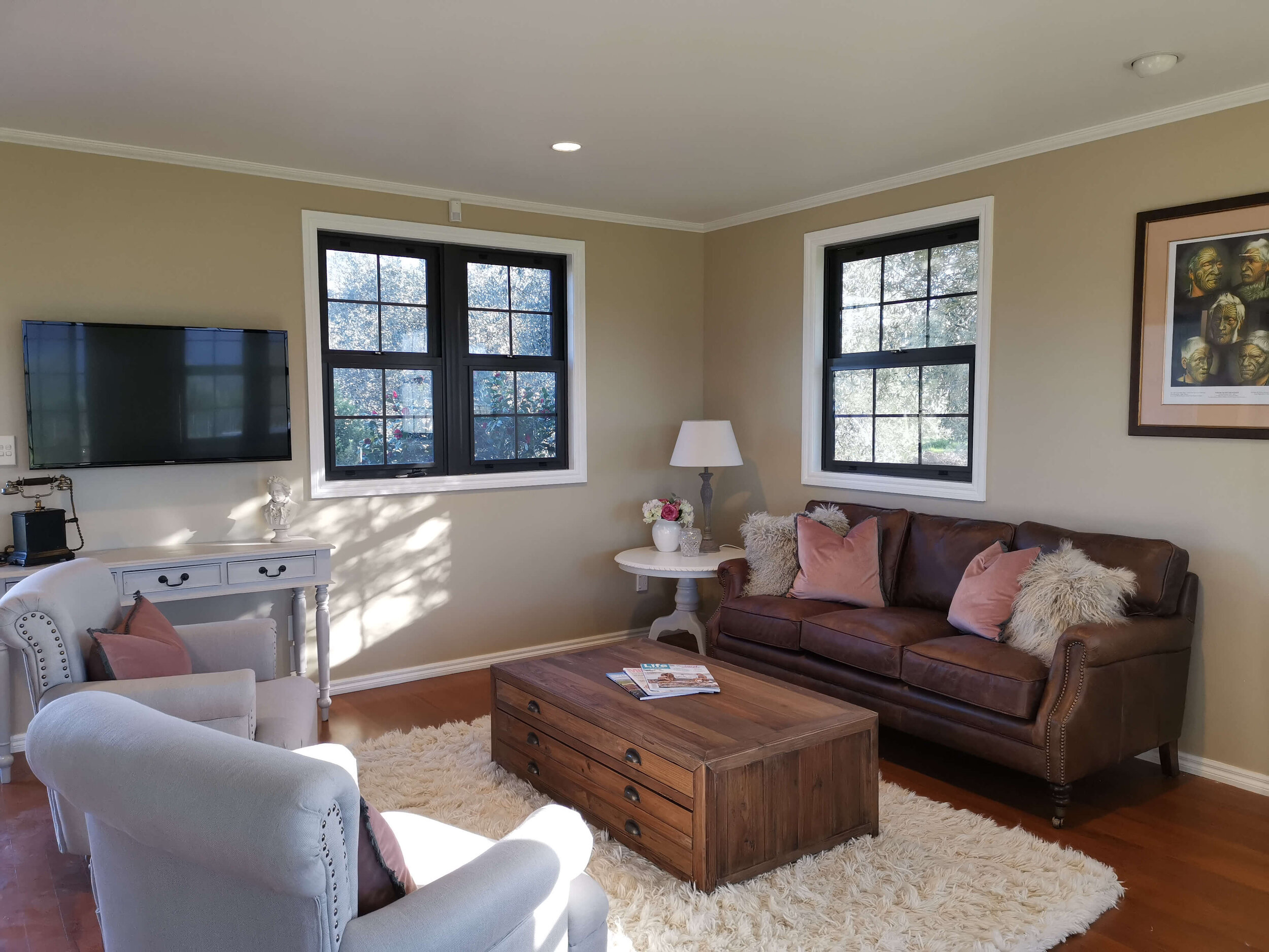 The newly renovated lounge of Vineyard Cottage offers a cozy place to relax after a full day sight-seeing.