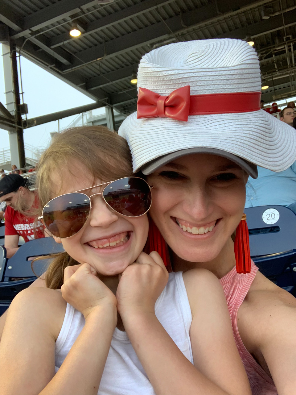Having fun with my girl at a baseball game.