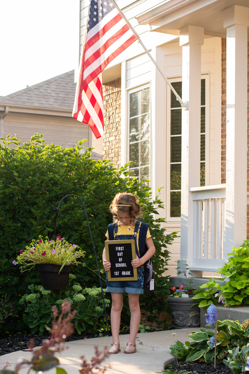 First day of school with flag and letter board