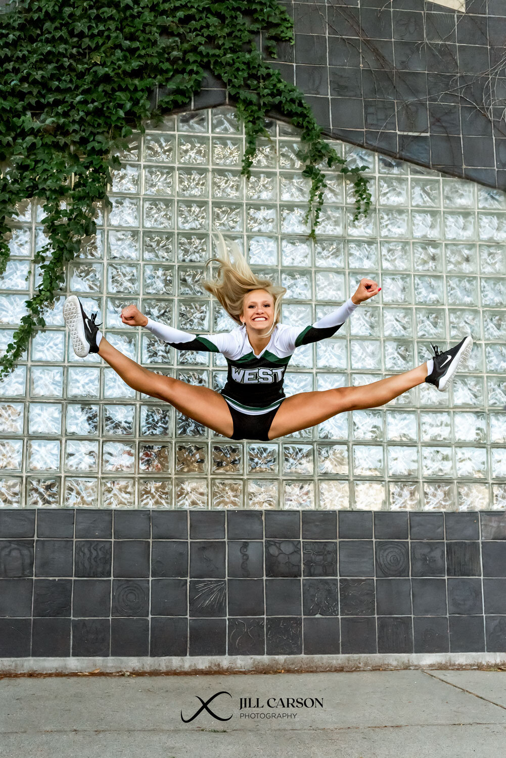 Senior cheerleader toe touch