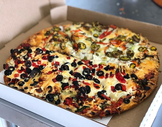 Don't forget we do half and half's! The perfect way to please everyone! This one here is a Mediterranean veggie and spicy Mexican! On our willows regular crust! #victoriapizza #yyj #local #supportlocal #fresh #pizza #veggie #cheese #likeforlikes