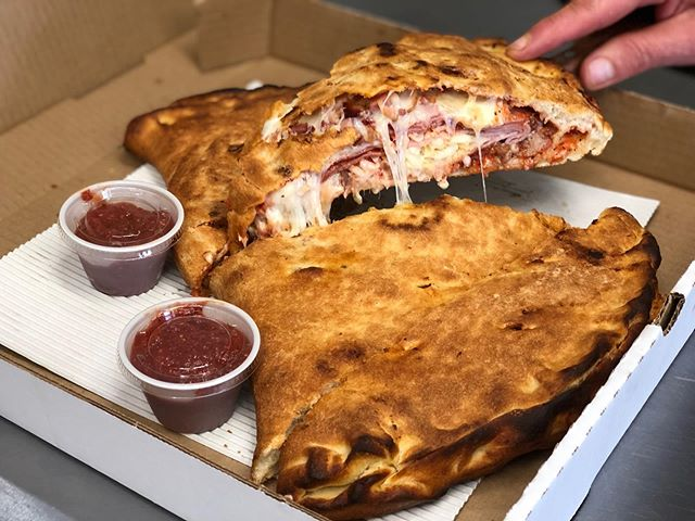 Our LARGE calzone! (Size comparison to Megan's hand LOL) Enough to feed 3 people for 15$! 🤤 this one is a meat lovers but you can pick anything you want in these bad boys! Comes in small, medium, and large! 🤩 #yum #calzone #pizza #fresh #local #yyj #food #victoria