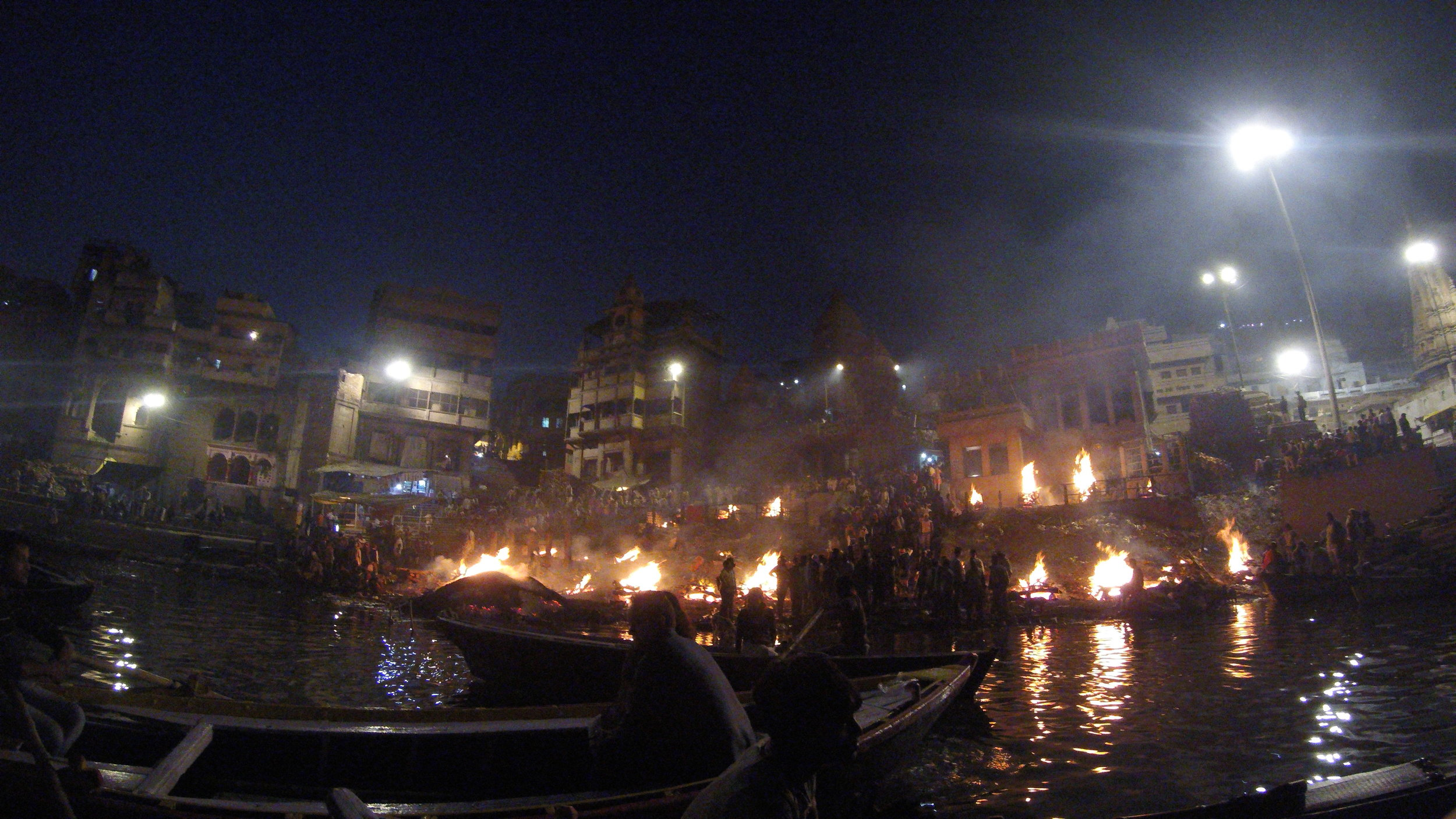 View of Manikarnika Ghat from the river at night