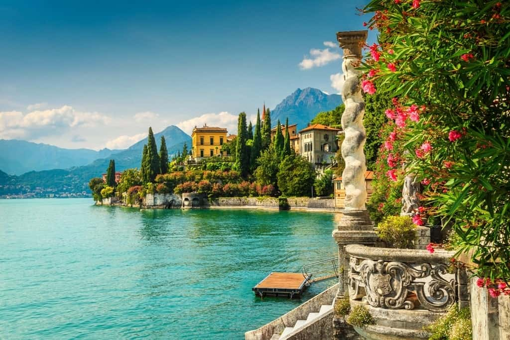 Famous-luxury-villa-Monastero-stunning-botanical-garden-decorated-with-mediterranean-oleander-flowers-lake-Como-Varenna-Lombardy-region-Italy-Europe-min.jpg