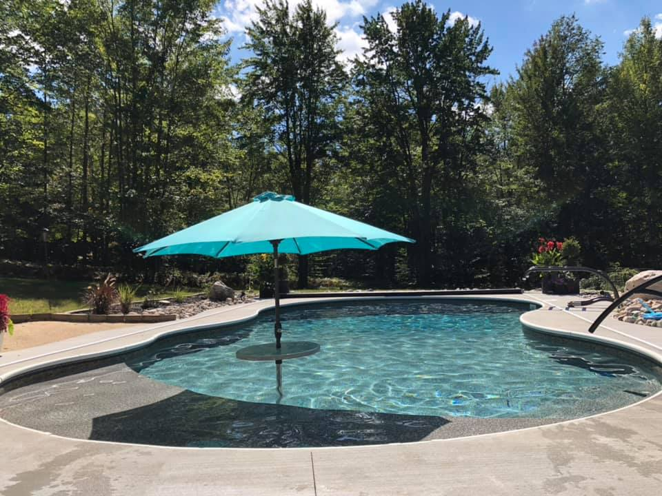 Cadillac, MI - Show Stopper!!! Fully custom free form pool, with tanning ledge, vinyl over steps, LED lighting, Coverstar automatic pool cover.