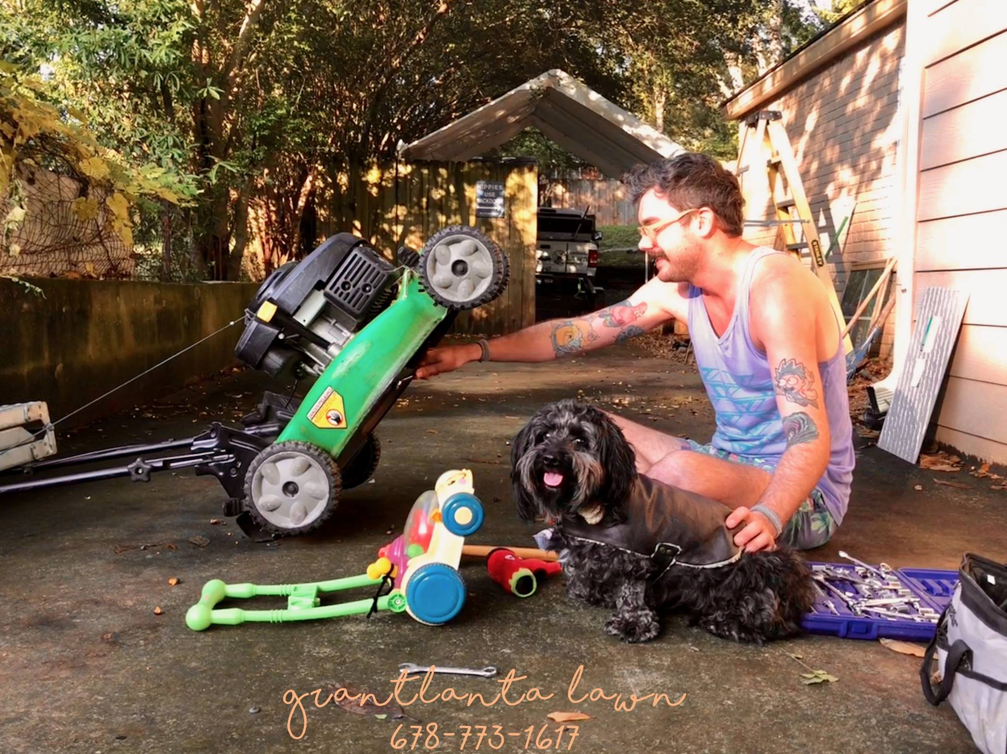 Grant and Sophie Fixing Lawnmowers Grantlanta Lawn Landscaping Services Near Atlanta