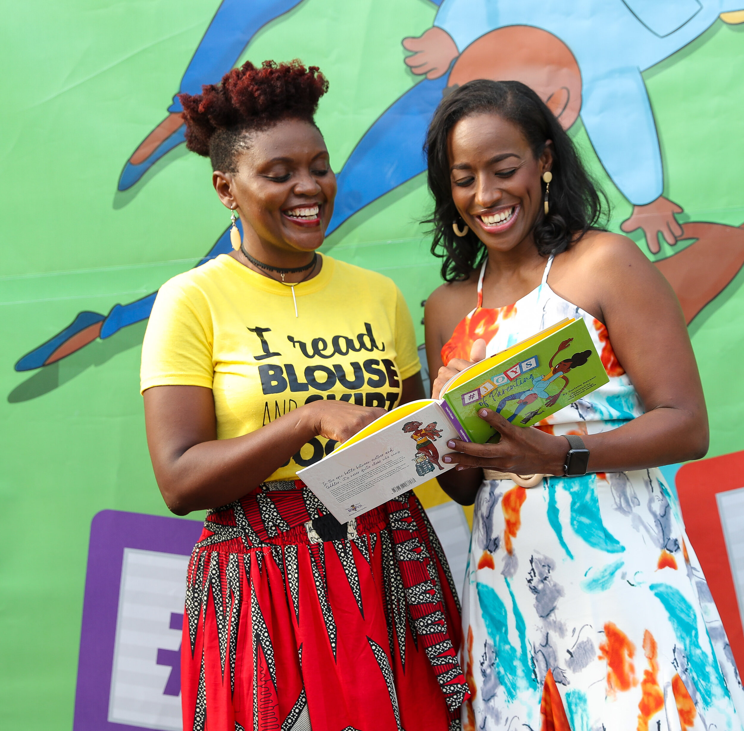 Carlette DeLeon (r) author of the #JoysOfParenting shared a joyous moment with Tanya Batson-Savage owner of publishing house Blouse and Skirt Books an imprint of Blue Banyan Books during the launch of the book held on Saturday July 27 at the Hope Zoo Tree House.