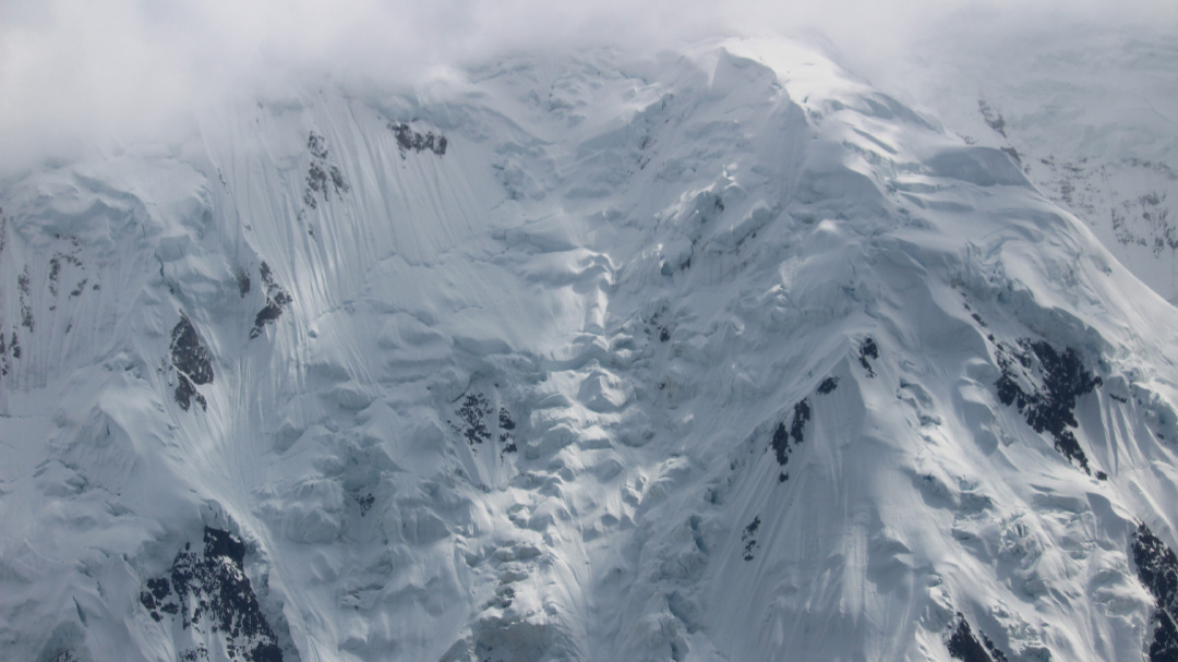 A close-up of forbidding terrain along the flank of the mountain, next to the Muldrow Glacier