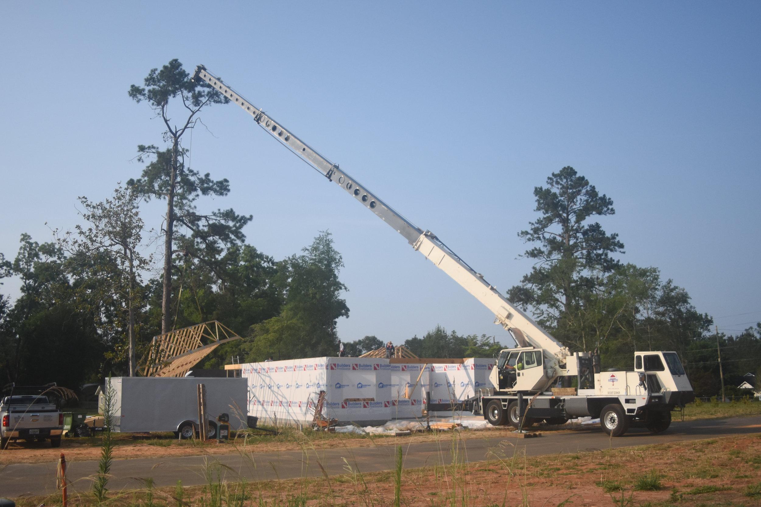 40 ton crane assists builders set truss roof system.JPG
