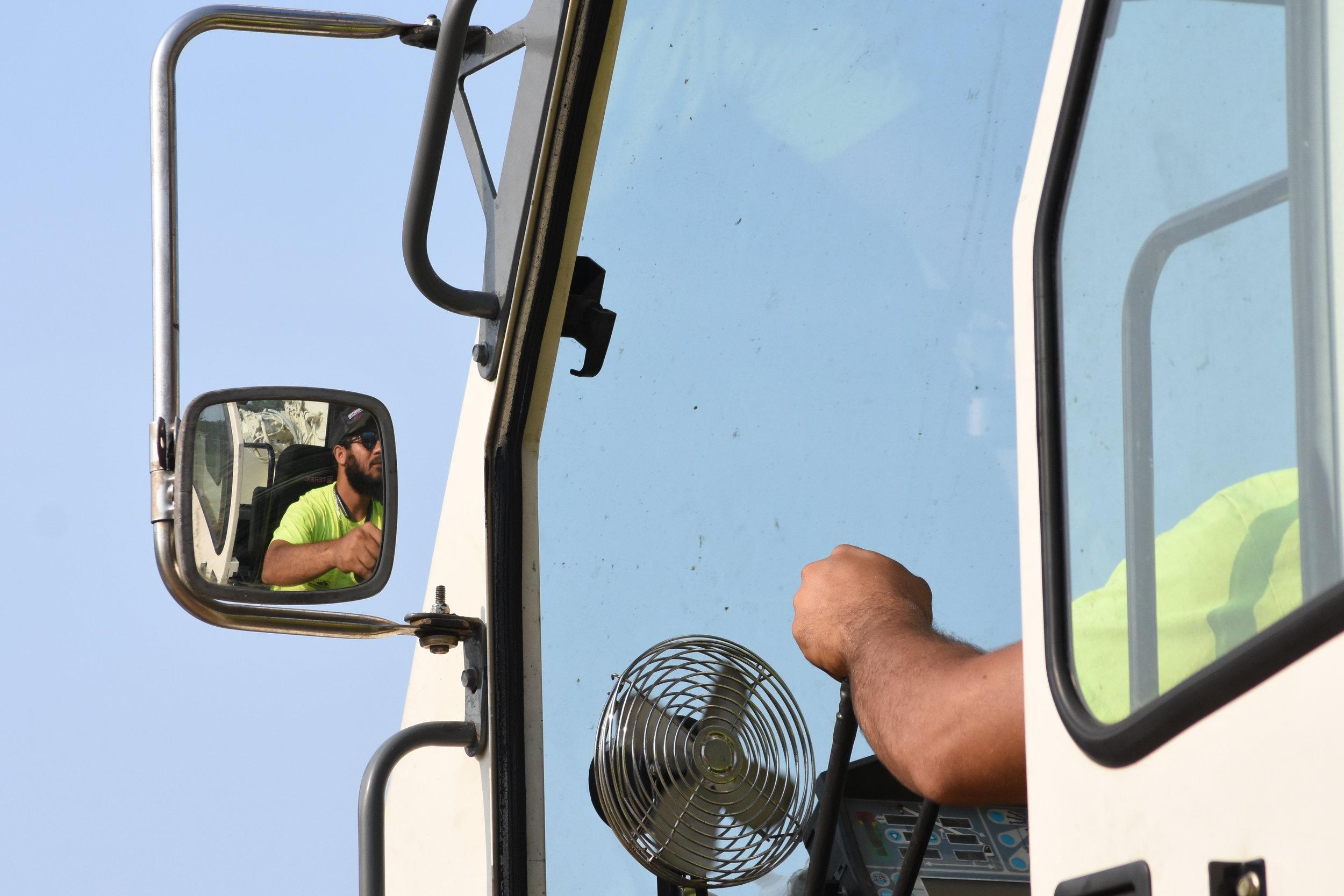 crane operator close up in mirror hands on controls focused.JPG