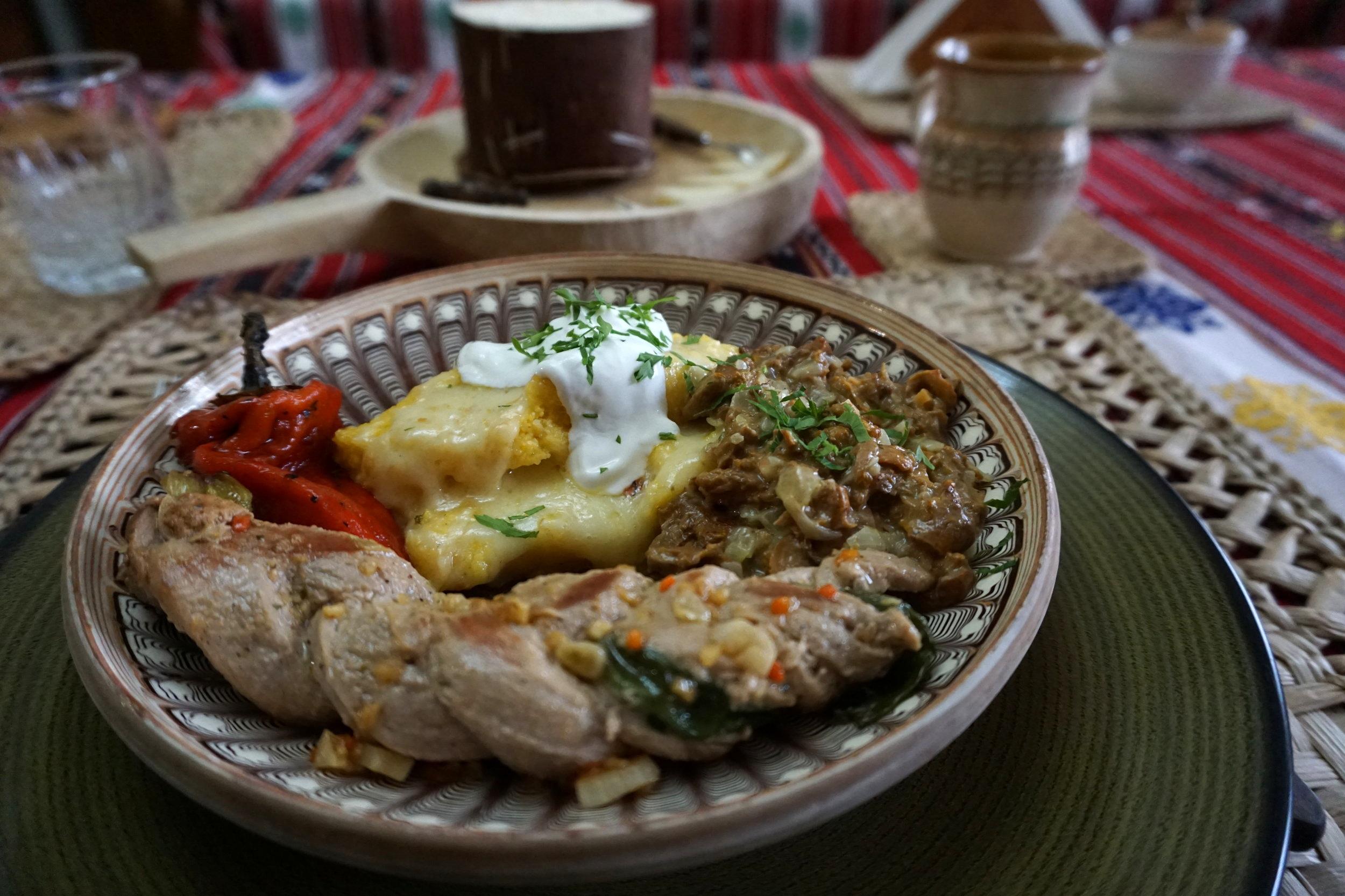 Romanian main dish: roasted pork, polenta, wild mushrooms and baked bell paper.