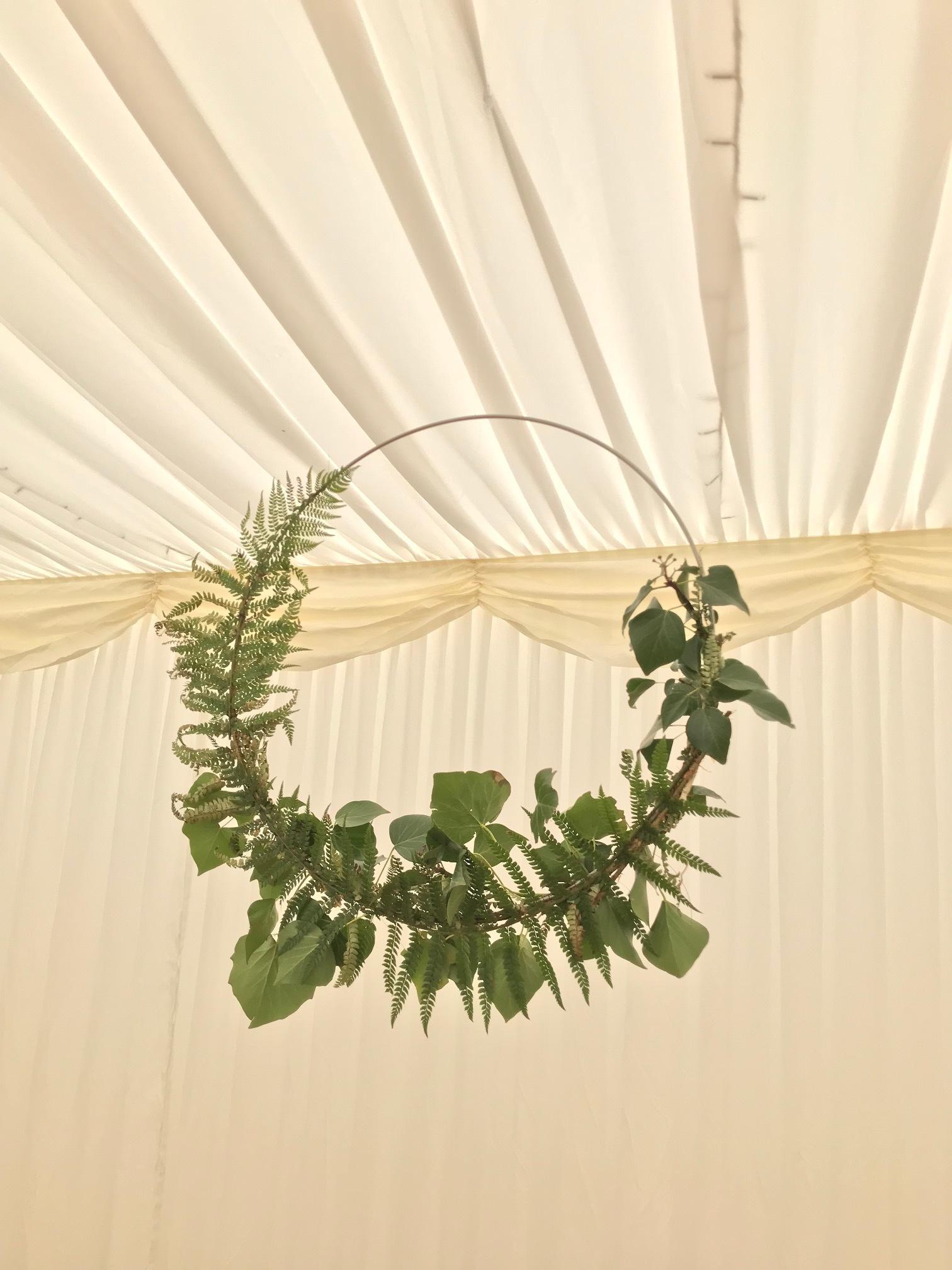Foliage hoops at a wedding