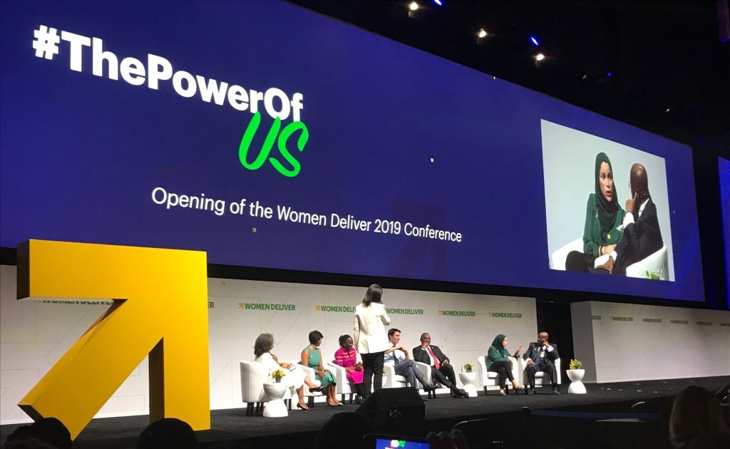 The theme of the opening plenary of Women Deliver 2019 was  The Power of Us . Panelists from left to right as seen on stage: President Sahle-Work Zewde, Farwiza Farhan, Natasha Mwansa, Prime Minister Justin Trudeau, President Uhuru Kenyatta, Dr. Alaa Murabit, President Nana Addo Dankwa Akufo-Addo.  Seen on screen: Dr. Alaa Murabit and President Nana Addo Dankwa Akufo-Addo.