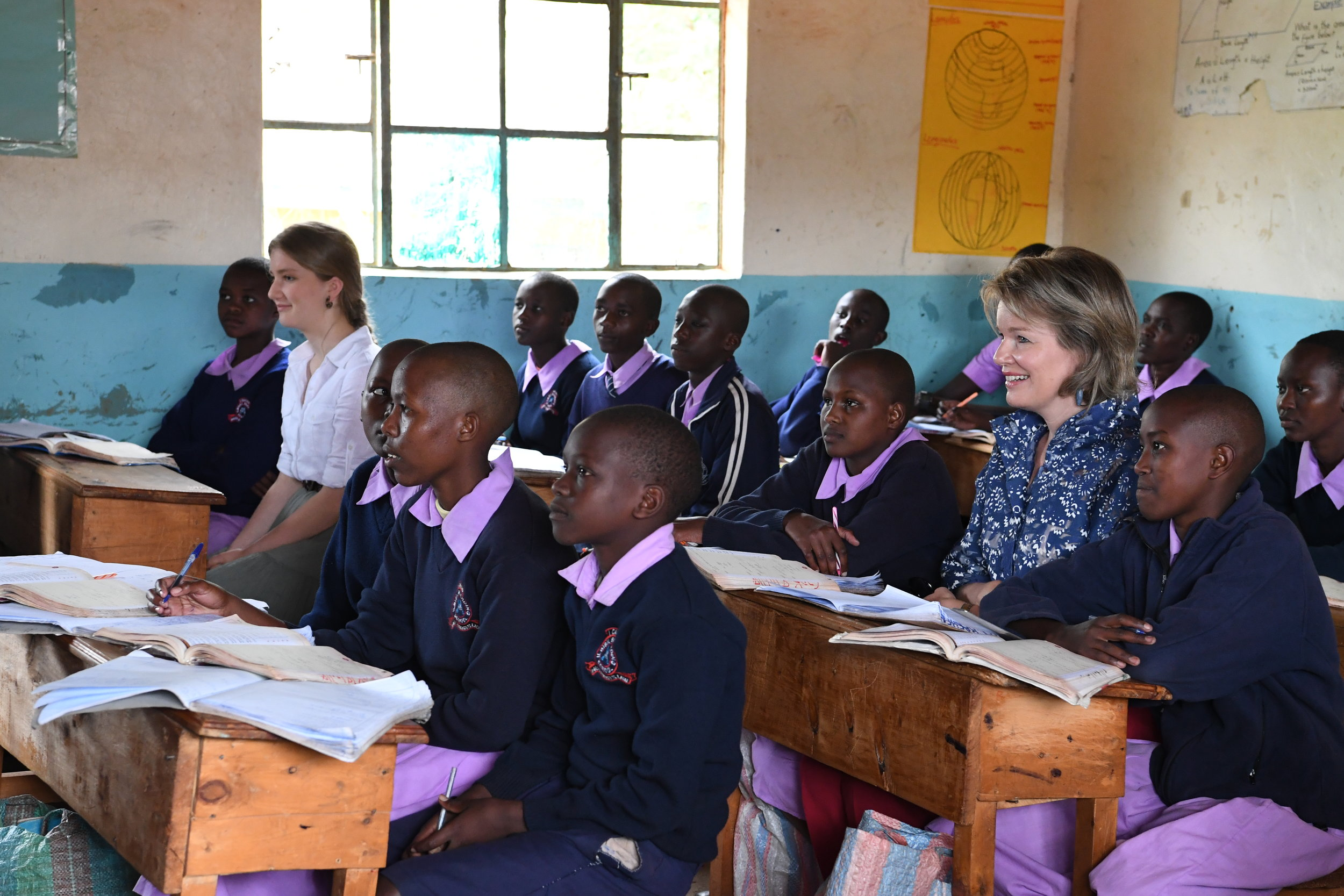 Her Majesty Queen Mathilde and Princess Elisabeth sit in on class in Maasai.