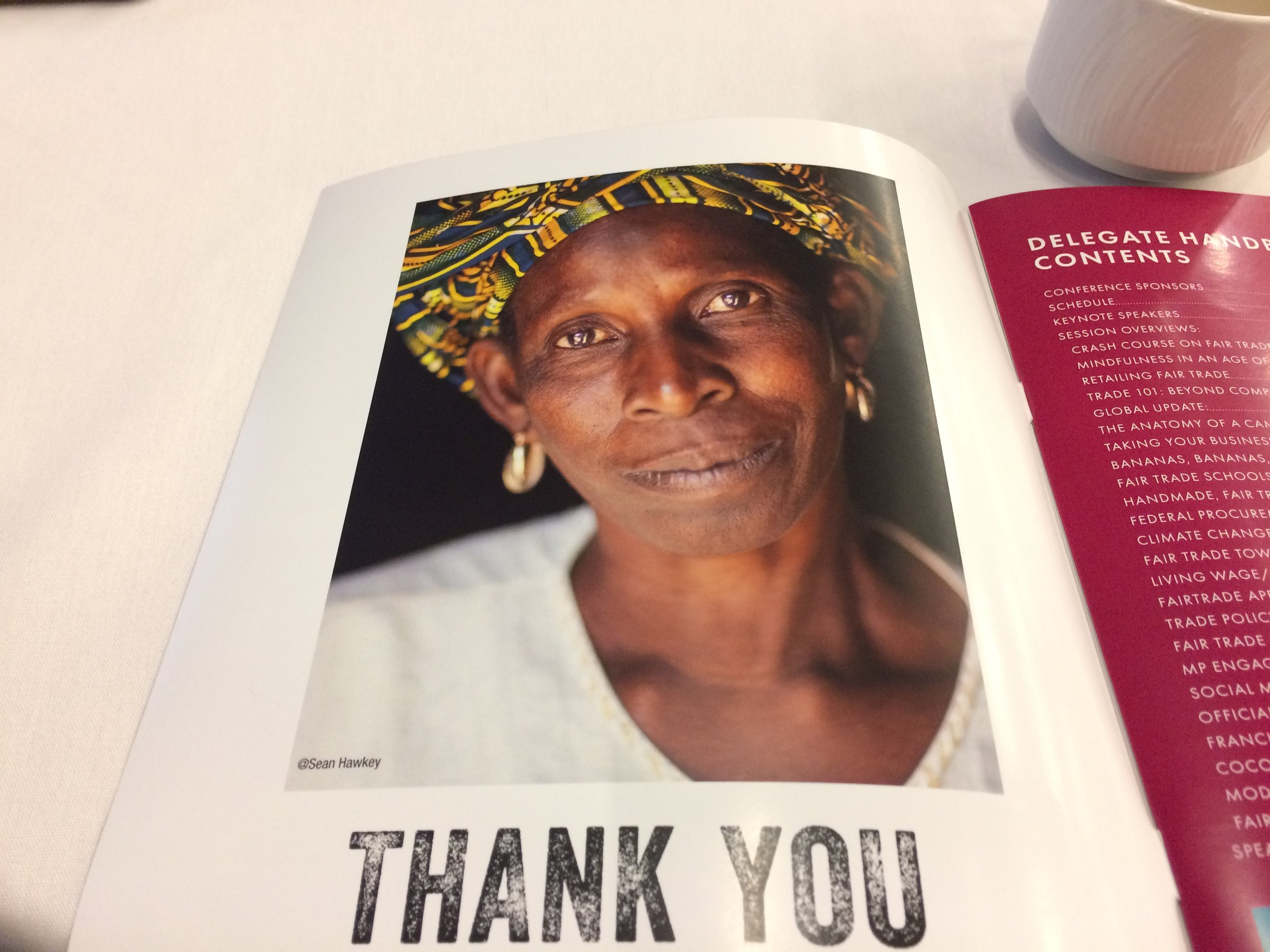 A page in the Conference program acknowledging Divine chocolates and one of their workers in Africa