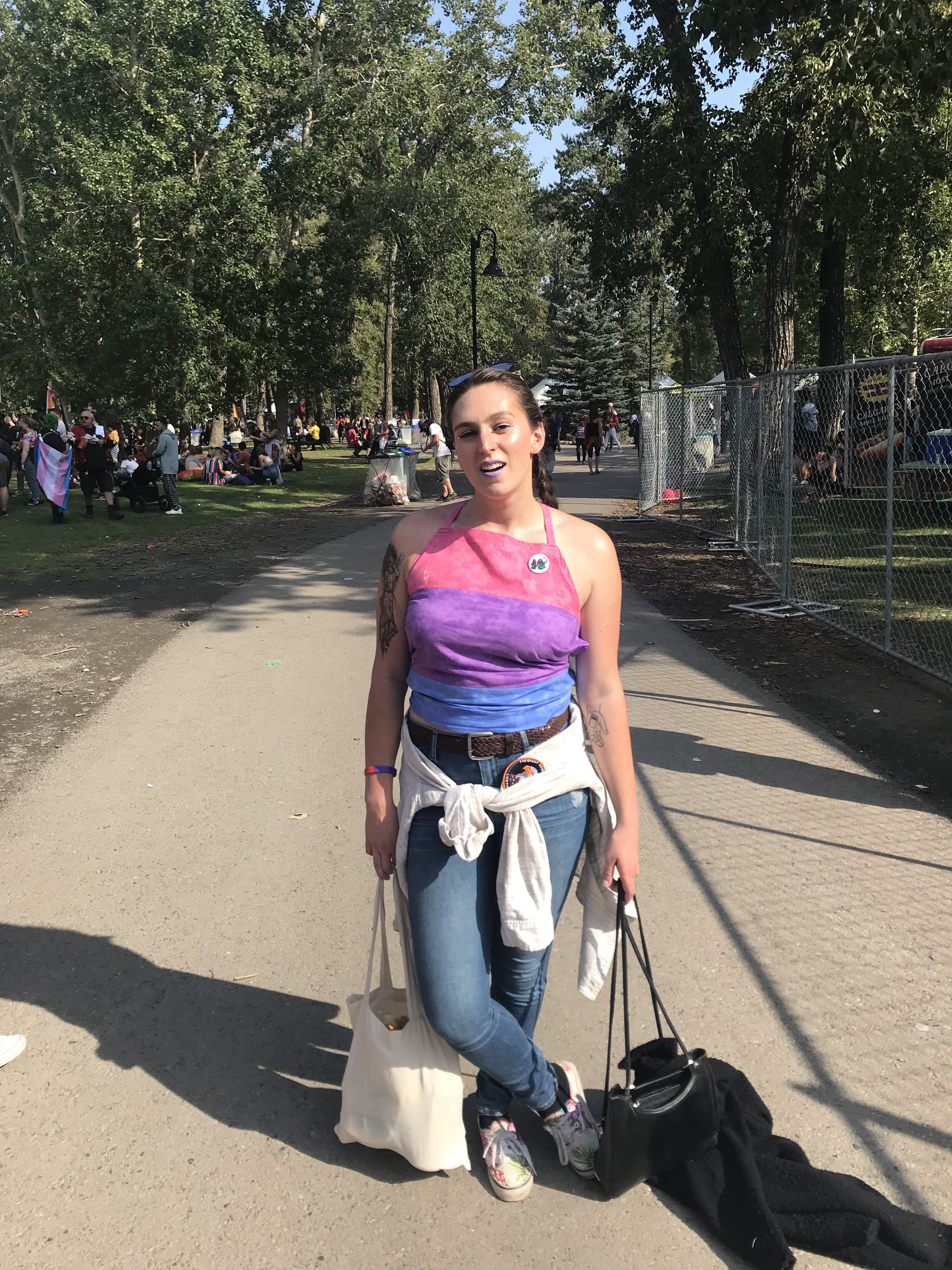 Calgary Pride 2018 wearing a self sewn and drafted Bisexual pride halter top.