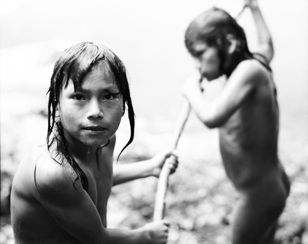 Kunang and Wichin working on their canoe. This are the two sons of chief Elias from the tribe of the Chuars.