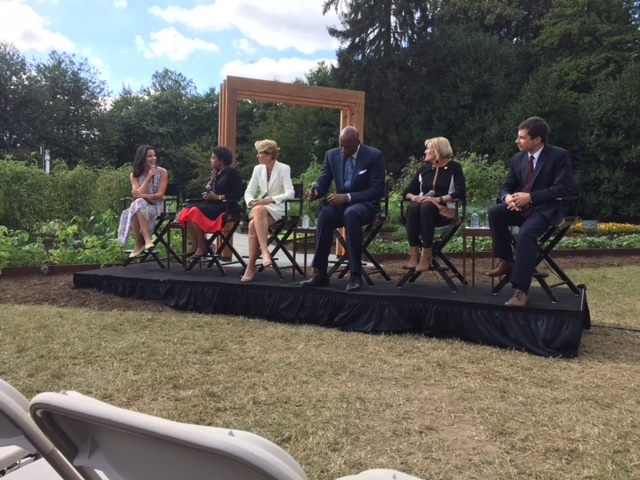 This is a panel discussion next to the First Lady's kitchen garden on the White House grounds. In the middle is NBA legend Alonzo Mourning (who spent 20 minutes telling me all about his life post-basketball). On the right is 2020 Presidential Candidate Pete Buttigieg. This event happened in October of 2016 and there was already buzz for Mayor Pete's future. The empty chair in front of me was filled with Alonzo Mourning while Michelle Obama spoke. So of course, I couldn't see her. Mr. Mourning is really, freakin' tall (and very kind).