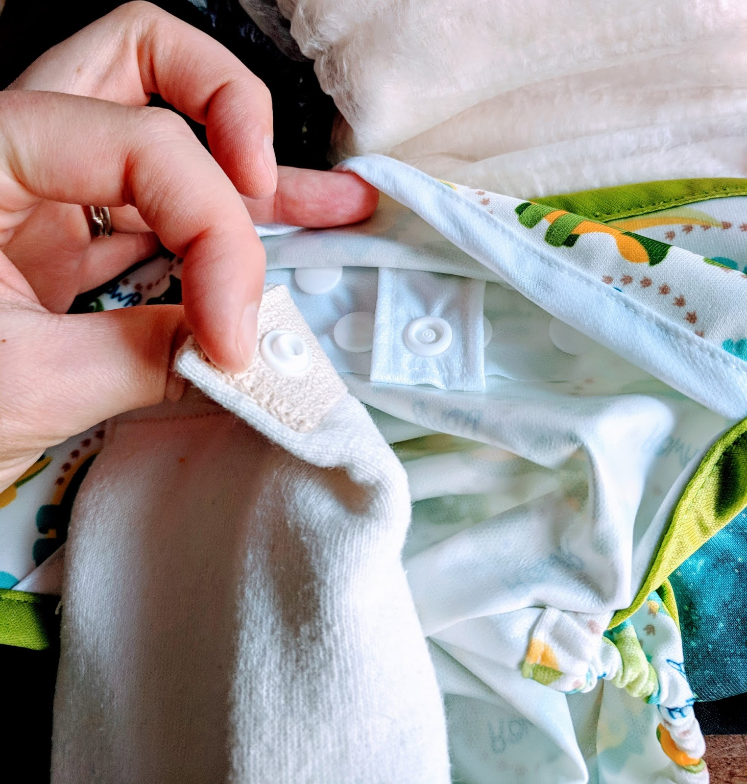Tidy Tots - Tidy Tots is the healthiest choice for baby. Our No Fold diaper is made from a 100% organic hemp blend. Our Flushies are made from an organic blend too.Using natural and organic products next to your baby's delicate bum ensures that you are reducing their exposure to chemicals. Common sense indicates that baby's wet bottom sitting in chemicals is not the healthiest of choices. Happy days and peaceful nights. Our hemp diapers keep your baby dry and leak free, which makes for a content baby and delighted family.Hemp is an ideal choice for cloth diaper material because of its unparalleled absorbency and natural antibacterial properties which helps keep baby rash free.