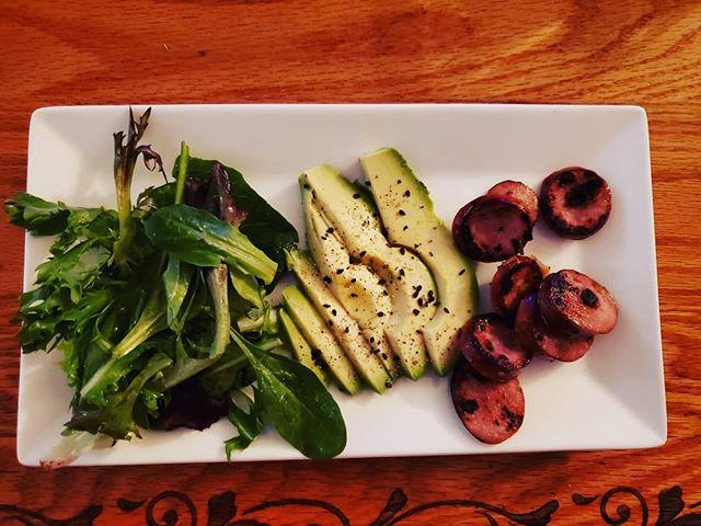 Simple, delicious, low carb breakfast of apple chicken sausage, some avocado and a small salad.  #healthy #breakfast #avocado #savetheavocados #cooking