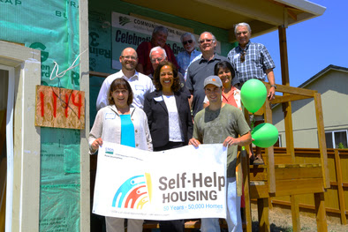 Lisa Mensah joined USDA Rural Development State Director Vicki Walker, local officials, and representatives from the nonprofit Community Home Builders to tour the homes being built by rural Oregonians through the self-help method in Lafayette.