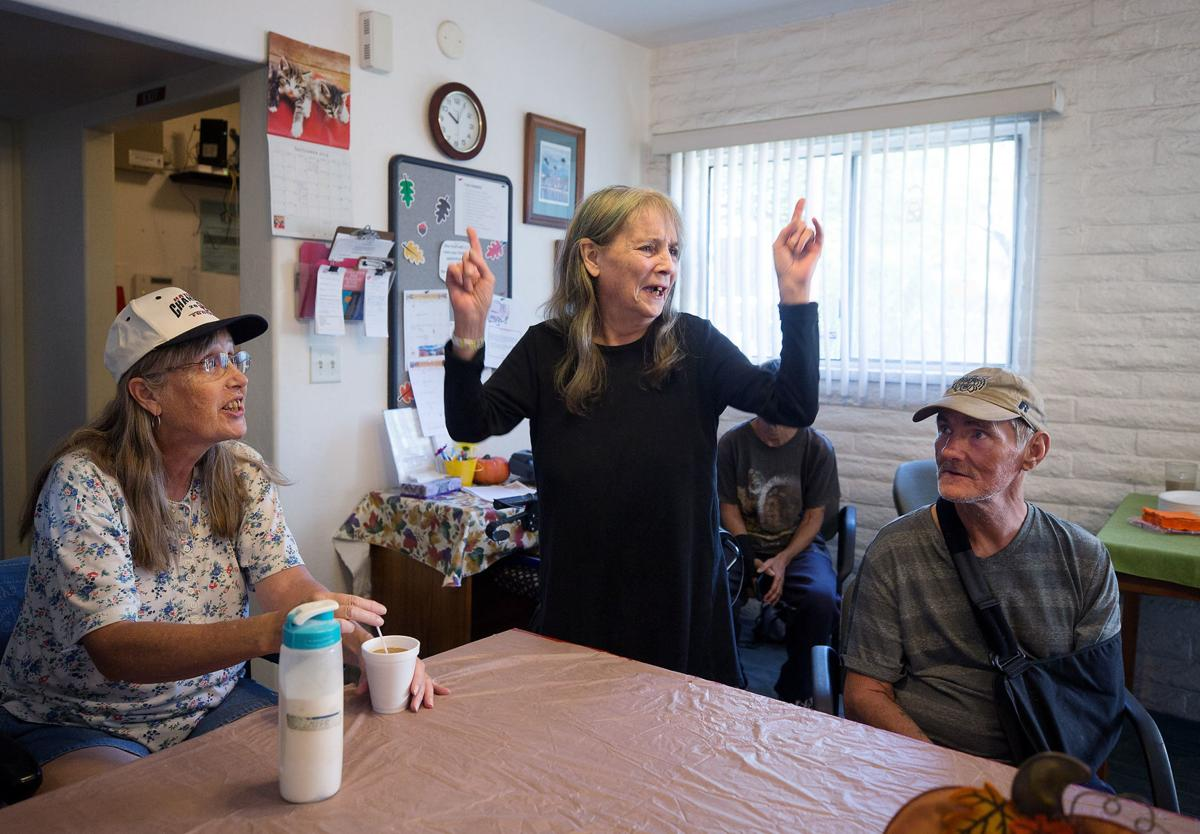 Peggy Graves, middle, is the birthday girl and takes in all the attention as residents at Miracle Square, 2601 N Oracle Rd., gather in the front office for cake and celebration on September 26, 2019. Miracle Square helps adults with disabilities and the elderly to live independently.  Mamta Popat / Arizona Daily Star