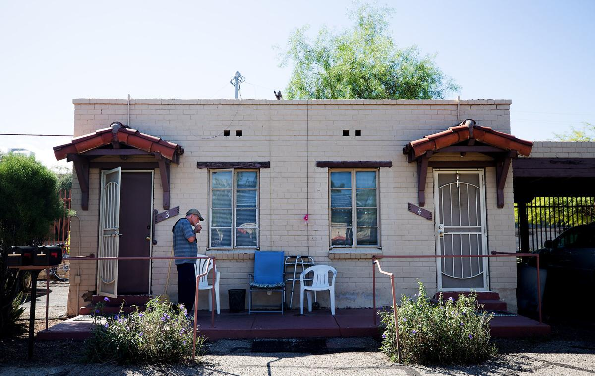 Fred Worthington lights up a cigarette after stepping out of his studio apartment at Miracle Square, 2601 N Oracle Rd., on September 26, 2019. Miracle Square helps adults with disabilities and the elderly to live independently.  Mamta Popat / Arizona Daily Star